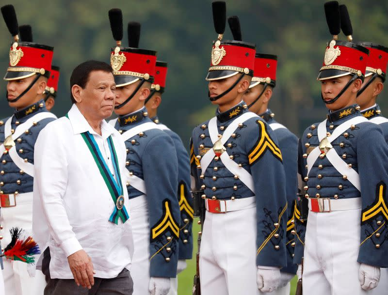 FILE PHOTO: Philippines President Rodrigo Duterte reviews military cadets during change of command ceremonies of the Armed Forces of the Philippines (AFP) at Camp Aguinaldo in Quezon City, metro Manila