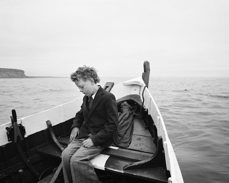 Simon being taken to sea for the first time since his father drowned, Skinningrove, North Yorkshire, 1983 - Chris Killip