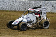 Jeff Gordon, a five-time winner of the Brickyard 400 and four-time NASCAR Cup Series champion, drives through a turn in a USAC midget car during an exhibition on the dirt track in the infield a Indianapolis Motor Speedway in Indianapolis, Thursday, June 17, 2021. (AP Photo/Michael Conroy)