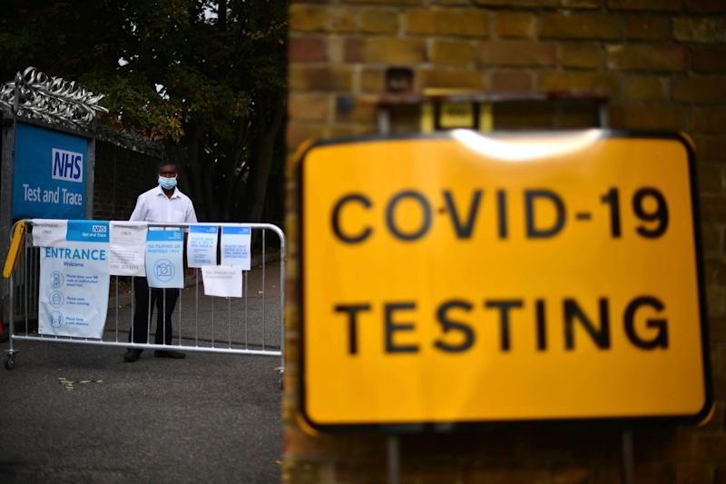 <strong>A member of staff stands at the entrance to a coronavirus testing centre in Newham, east London</strong> (Photo: ASSOCIATED PRESS)