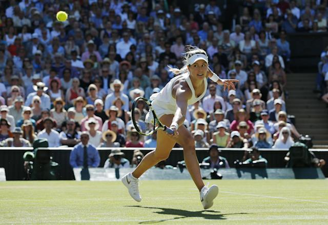Eugenie Bouchard of Canada runs to play a return to Simona Halep of Romania during their women's singles semifinal match at the All England Lawn Tennis Championships in Wimbledon, London, Thursday, July 3, 2014. (AP Photo/Ben Curtis)