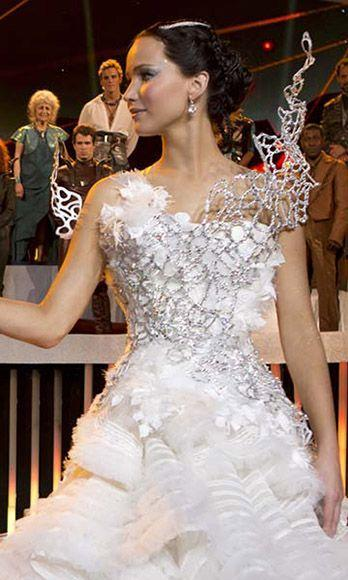 <p>Did Katniss Everdeen ever end up marrying Peeta Mellark in the <em>Hunger Games</em> movies? Debatable. But did Jennifer Lawrence get to wear a stunning, futuristic wedding dress either way? She sure did. </p>