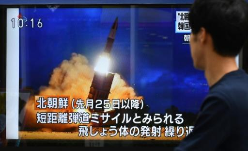 A pedestrian in Tokyo watches a television report on the latest North Korean launch