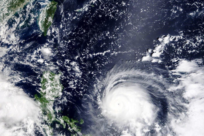 In this Thursday, Sept, 9, 2021, satellite image released by NASA, Typhoon Chanthu, right, develops into a powerful typhoon moving towards Taiwan, top left. Chanthu continues gaining strength and is expected to make landfall in Taiwan over the weekend. (NASA Worldview, Earth Observing System Data and Information System (EOSDIS) via AP)