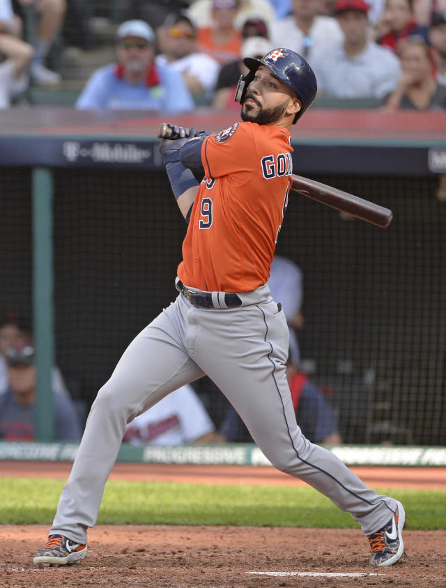 Houston Astros' Marwin Gonzalez hits a two-run double in the seventh inning during Game 3 of a baseball American League Division Series against the Cleveland Indians, Monday, Oct. 8, 2018, in Cleveland. Jose Altuve and Alex Bregman scored on the play. (AP Photo/Phil Long)