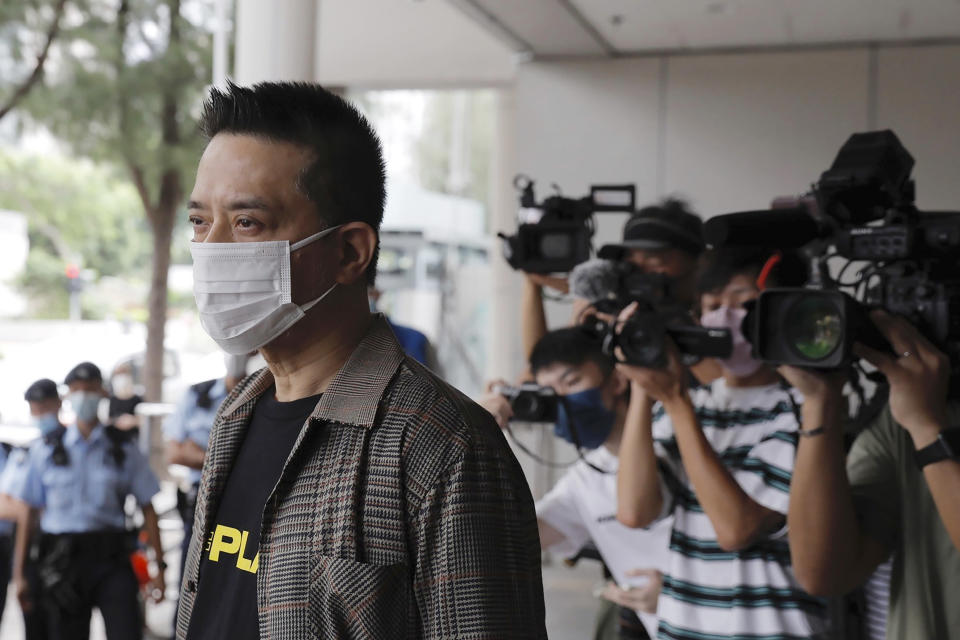 Hong Kong singer and pro-democracy activist Anthony Wong arrives at a court Thursday, Aug. 5, 2021. Wong, who was charged with corrupt conduct for allegedly providing entertainment to voters to sway their votes in a by-election, had the charges dropped on Thursday. (AP Photo/Matthew Cheng)