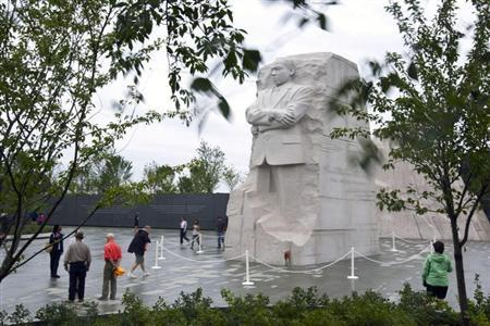 Tourists visit the Martin Luther King Memorial the morning after Hurricane Irene passed by Washington