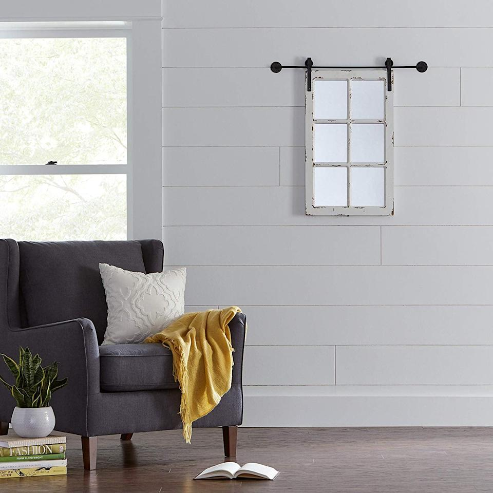 <p>For a dreamy rustic touch, just add the <span>Stone & Beam Vintage-Look Rectangular Frame White Window Wood Mirror</span> ($83) to your space.</p>