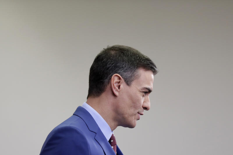 Spain's Prime Minister Pedro Sanchez addresses the media at the Moncloa Palace in Madrid, Spain, Sunday, Jan. 12, 2020. Sanchez was chosen by Parliament as prime minister on Tuesday, ending a period in which he led a caretaker Socialist government following two inconclusive elections last year. (AP Photo/Manu Fernandez)