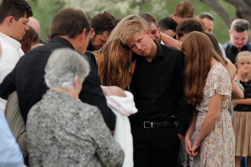 Relatives react during the funeral service of Dawna Ray Langford and her sons Trevor, Rogan, who were killed by unknown assailants, before buried at the cemetery in La Mora