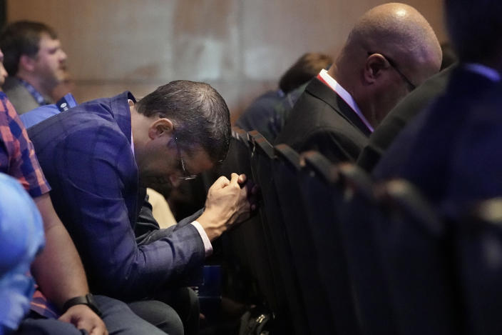 A man prays during the executive committee plenary meeting at the Southern Baptist Convention's annual meeting Monday, June 14, 2021, in Nashville, Tenn. (AP Photo/Mark Humphrey)