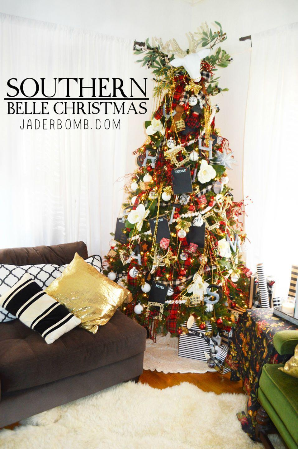 """<p>Olive branches, gorgeous magnolias, glass glitter on frames, plaid ribbon, and cotton balls transform this tree into an evergreen Southern Belle.</p><p><em><strong>Get the tutorial at </strong><strong><a href=""""https://jaderbomb.com/?s=southern+belle+christmas+tree"""" rel=""""nofollow noopener"""" target=""""_blank"""" data-ylk=""""slk:Jader Bomb"""" class=""""link rapid-noclick-resp"""">Jader Bomb</a>.</strong></em></p><p><a class=""""link rapid-noclick-resp"""" href=""""https://www.amazon.com/Berwick-2-Inch-50-Yard-Clarkston-Ribbon/dp/B0091SC1AO/?tag=syn-yahoo-20&ascsubtag=%5Bartid%7C10070.g.2025%5Bsrc%7Cyahoo-us"""" rel=""""nofollow noopener"""" target=""""_blank"""" data-ylk=""""slk:BUY PLAID RIBBON"""">BUY PLAID RIBBON</a></p>"""