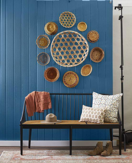 <p>A bevy of baskets brings ample texture to a room. Using nails, hang a larger basket in the middle, then surround with smaller baskets in a circular or starburst pattern.</p>