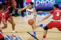 DePaul guard Sonya Morris, center, drives against St. John's guard Qadashah Hoppie, left, and guard Leilani Correa during the second half of an NCAA college basketball game in Chicago, Wednesday, Jan. 13, 2021. (AP Photo/Nam Y. Huh)