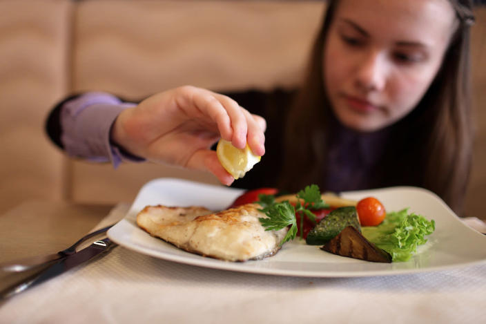 A new study shows that eating fish may improve children's IQ by helping them sleep better. (Photo: Getty Images)