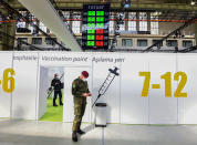 A soldier of the German Armed Forces Bundeswehr stands inside a new vaccination centre at the former Tempelhof airport in Berlin, Germany, before its opening on Monday, March 8, 2021. (Tobias Schwarz / Pool via AP)
