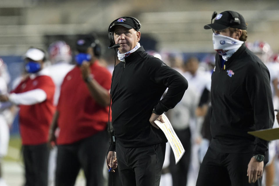 Louisiana Tech coach Skip Holtz looks at the scoreboard during the first half of the team's NCAA college football game against BYU on Friday, Oct. 2, 2020, in Provo, Utah. (AP Photo/Rick Bowmer, Pool)