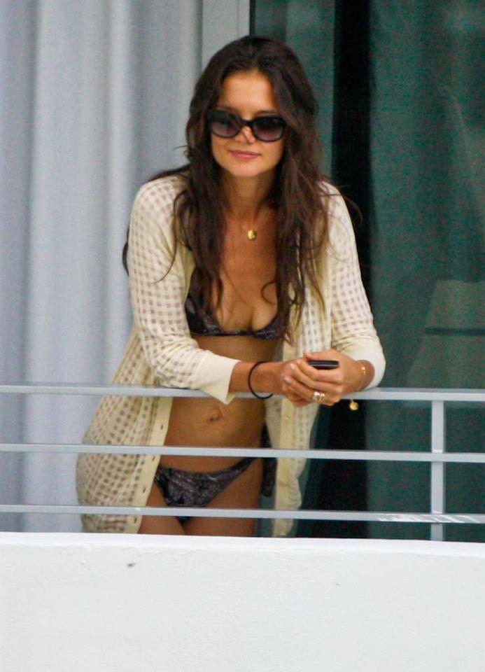 """Katie Holmes is """"desperate to be skinny,"""" says <i>Life & Style</i>, which notes the actress is on a """"near-hunger strike,"""" substituting Diet Coke and tea for food. The mag also says she has gone overboard with Pilates, spinning, and running, explaining that Tom Cruise has """"taken over every aspect of her life, but only she has control over her body."""" For how """"painfully thin"""" Holmes has become, and what's being done to help her, log on to <a href=""""http://www.gossipcop.com/katie-holmes-too-skinny-weight-loss-eating-disorder-exercise- tom-cruise/"""" target=""""new"""">Gossip Cop</a>. Jcgo/Juan Garces/<a href=""""http://www.splashnewsonline.com"""" target=""""new"""">Splash News</a> - July 17, 2011"""