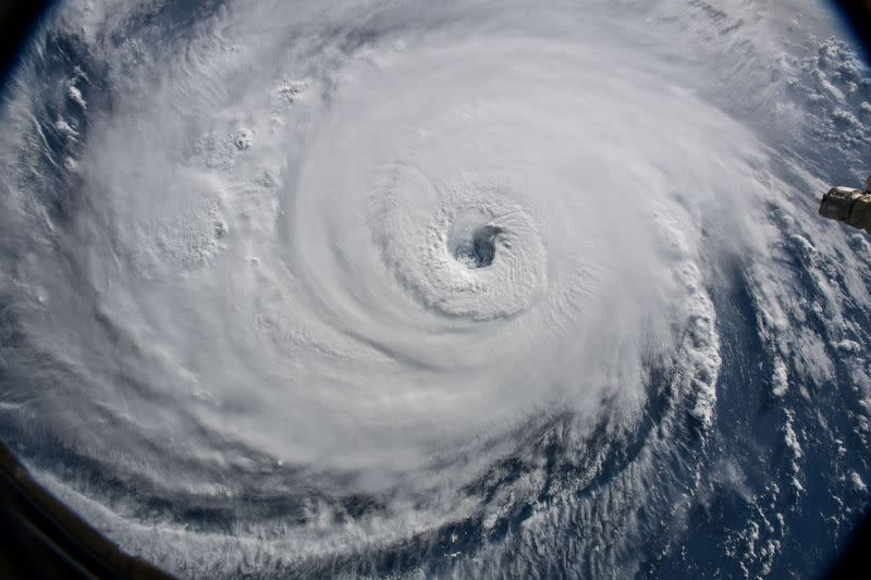 FILE PHOTO: NASA handout photo of a view of Hurricane Florence shown churning in the Atlantic Ocean in a west, north-westerly direction heading for the eastern coastline of the United States