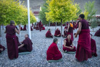Monks engage in debate in an outdoor area at the Tibetan Buddhist College near Lhasa in western China's Tibet Autonomous Region, Monday, May 31, 2021, as seen during a government organized visit for foreign journalists. High-pressure tactics employed by China's ruling Communist Party appear to be finding success in separating Tibetans from their traditional Buddhist culture and the influence of the Dalai Lama. (AP Photo/Mark Schiefelbein)