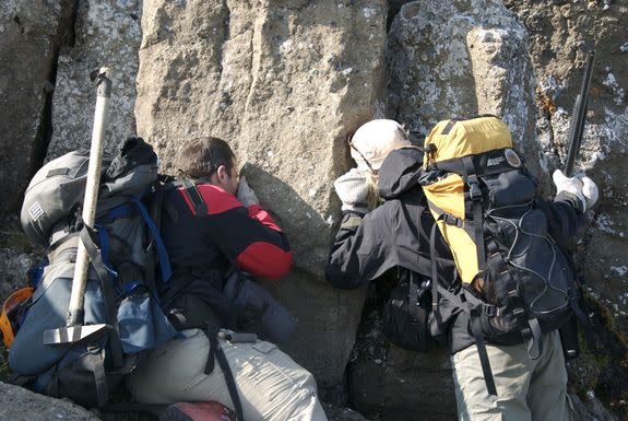 Geologists from the University of British Columbia examine pyroclastic deposits on the south side of the Kima'Kho volcano.