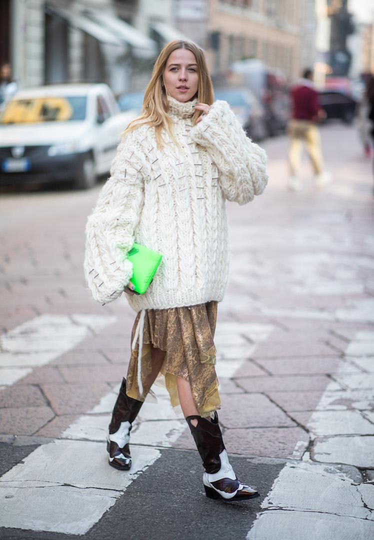<p>Jessica Mercedes Kirschner kept warm in a chunky knit, floral skirt and cowboy boots. <em>[Photo: Getty]</em> </p>