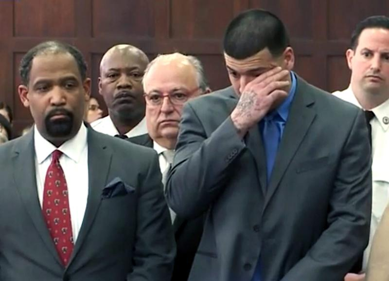 Aaron Hernandez, right, listens beside defence attorney Ronald Sullivan, - Credit: WHDH-TV/AP
