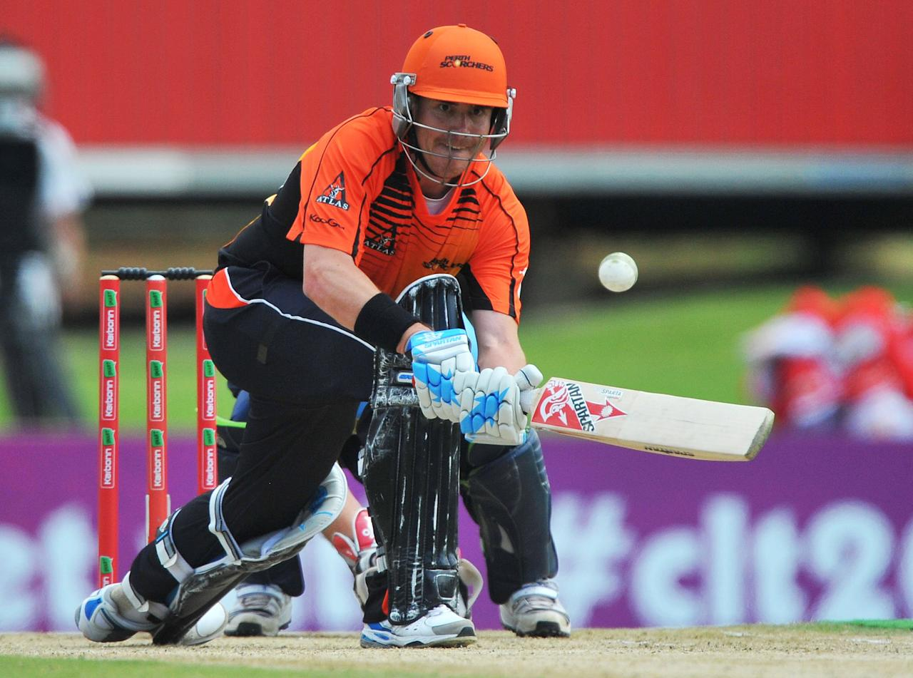 PRETORIA, SOUTH AFRICA - OCTOBER 23:  Marcus North of Perth sweeps a delivery during the Karbonn Smart CLT20 match between Auckland Aces and Perth Scorchers at SuperSport Park on October 23, 2012 in Pretoria, South Africa.  (Photo by Duif du Toit/Gallo Images/Getty Images)