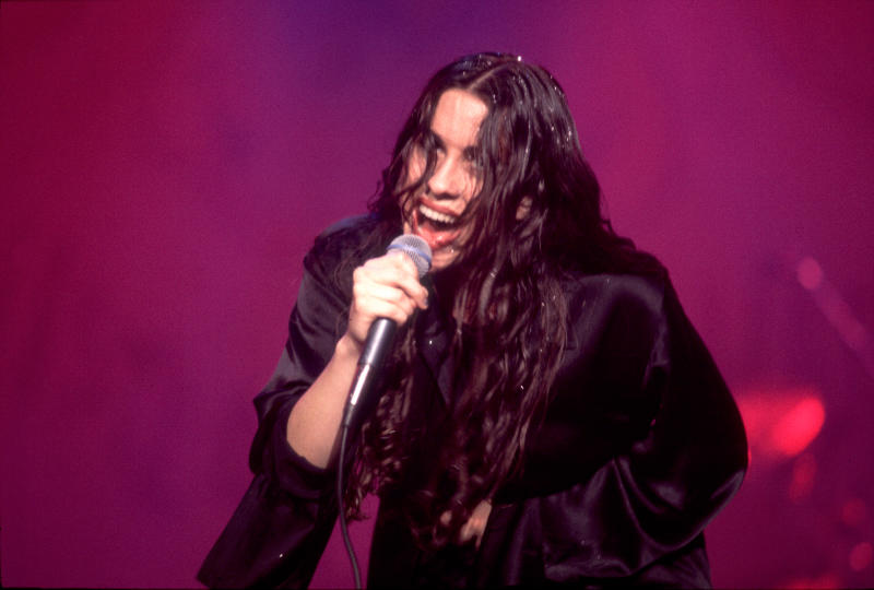 Morissette (performing in 1995) says she was pressured to lose weight and faced abusive behavior. (Photo: Paul Natkin/Getty Images)
