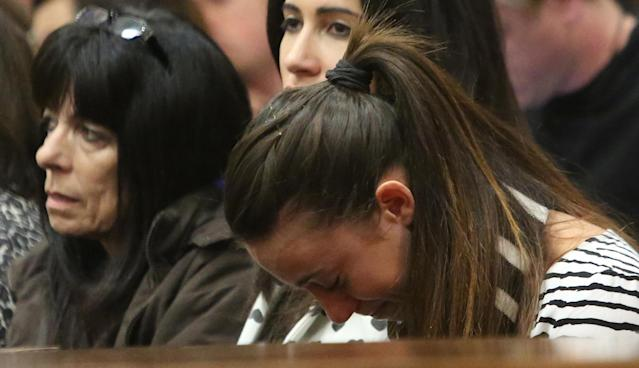PRETORIA, SOUTH AFRICA - APRIL 9: (SOUTH AFRICA OUT): Gina Myers, Reeva Steenkamp's best friend, is overcome with emotion as she listens to Oscar Pistorius' testimony in the Pretoria High Court on April 9, 2014, in Pretoria, South Africa. Oscar Pistorius stands accused of the murder of his girlfriend, Reeva Steenkamp, on February 14, 2014. This is Pistorius' official trial, the result of which will determine the paralympian athlete's fate. (Photo by Sydney Seshibedi - Pool/Getty Images)