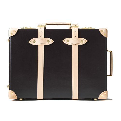 """<p><a class=""""link rapid-noclick-resp"""" href=""""https://www.globe-trotter.com/shop/luggage/safari-20-trolley-case-brownnatural/"""" rel=""""nofollow noopener"""" target=""""_blank"""" data-ylk=""""slk:SHOP"""">SHOP</a></p><p>Luggage was handsome in the days of pre-EasyJet yore. Handsome, but wholly impractical. Which is why Globe-Trotter's Safari 20"""" is a refreshing pivot, with the robust piece boasting a collapsible pull-out handle inside an old school shell.</p><p>Safari 20"""" Trolley Case, £1,385, <a href=""""https://www.globe-trotter.com/shop/luggage/safari-20-trolley-case-brownnatural/"""" rel=""""nofollow noopener"""" target=""""_blank"""" data-ylk=""""slk:globe-trotter.com"""" class=""""link rapid-noclick-resp"""">globe-trotter.com</a></p>"""