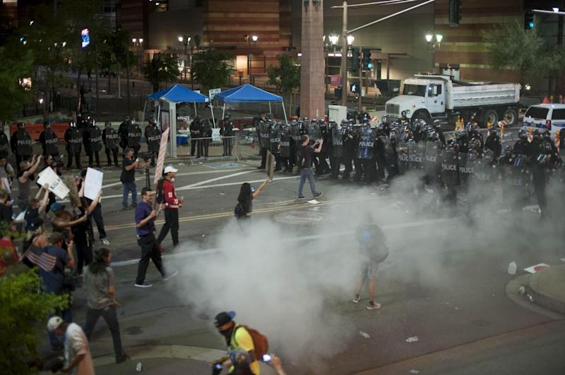 Face-off: Protesters and police during the clashes in Arizona