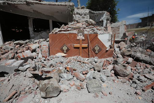 <p>Atrium of a church is seen inside debris of a destroyed building three days after the magnitude 7.1 earthquake jolted central Mexico killing more than 250 hundred people, damaging buildings, knocking out power and causing alarm throughout the capital on Sept. 22, 2017 in Mexico City, Mexico. (Photo: Hector Vivas/Getty Images) </p>