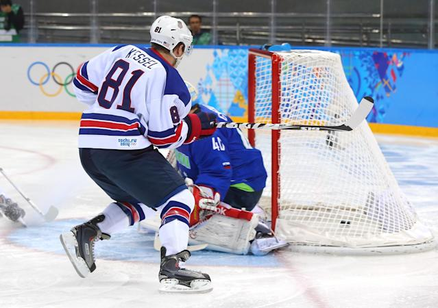 SOCHI, RUSSIA - FEBRUARY 16: Phil Kessel #81 of the United States scores against Luka Gracnar #40 of Slovenia in the first period during the Men's Ice Hockey Preliminary Round Group A game on day nine of the Sochi 2014 Winter Olympics at Shayba Arena on February 16, 2014 in Sochi, Russia. (Photo by Martin Rose/Getty Images)