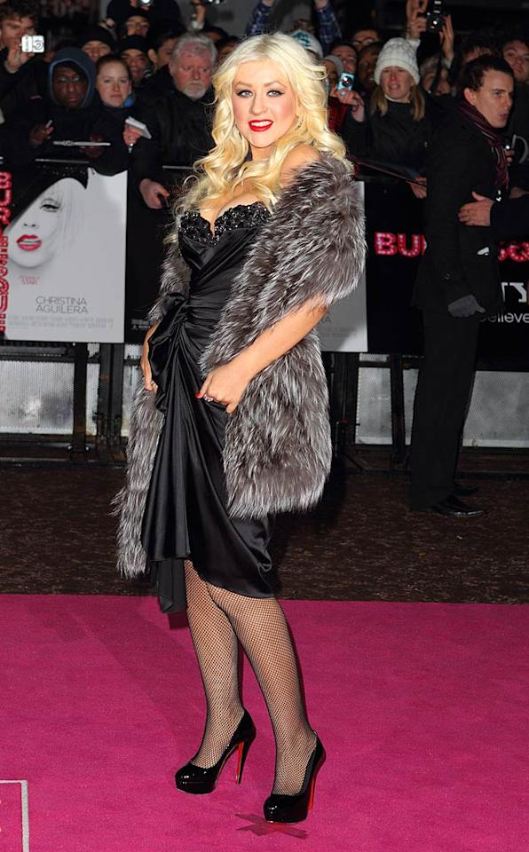 """Following in Cher's footsteps was her campy co-star Christina Aguilera, who appeared extremely uncomfortable in her chintzy-looking Zuhair Murad frock, fishnet stockings, and fur stole. Mike Marsland/<a href=""""http://www.wireimage.com"""" target=""""new"""">WireImage.com</a> - December 13, 2010"""
