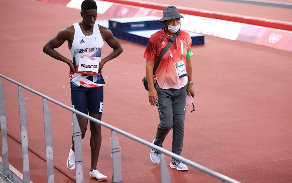 Reece Prescod of Britain walks off after being disqualified after a false start - Reuters
