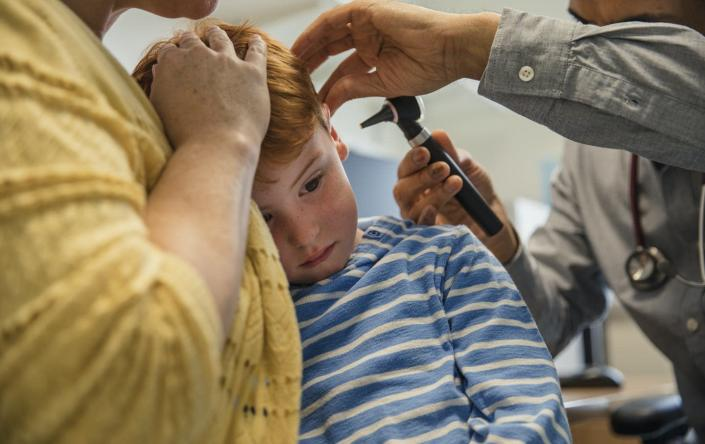 """<span class=""""caption"""">With a beam of light, an otoscope allows a clinician to examine the ear canal and eardrum.</span> <span class=""""attribution""""><a class=""""link rapid-noclick-resp"""" href=""""https://www.gettyimages.com/detail/photo/let-me-see-in-your-ear-royalty-free-image/878336612?adppopup=true"""" rel=""""nofollow noopener"""" target=""""_blank"""" data-ylk=""""slk:SolStock/E+ via Getty Images"""">SolStock/E+ via Getty Images</a></span>"""