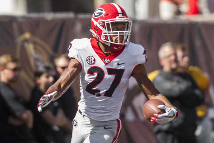 COLUMBIA, MO - SEPTEMBER 22:  Georgia Bulldogs defensive back Eric Stokes (27) looks back after scoring a touchdown from a blocked punt during the game between the Georgia Bulldogs and the Missouri Tigers on Saturday September 22, 2018 at Faurot Field in Columbia, MO.  (Photo by Nick Tre. Smith/Icon Sportswire via Getty Images)
