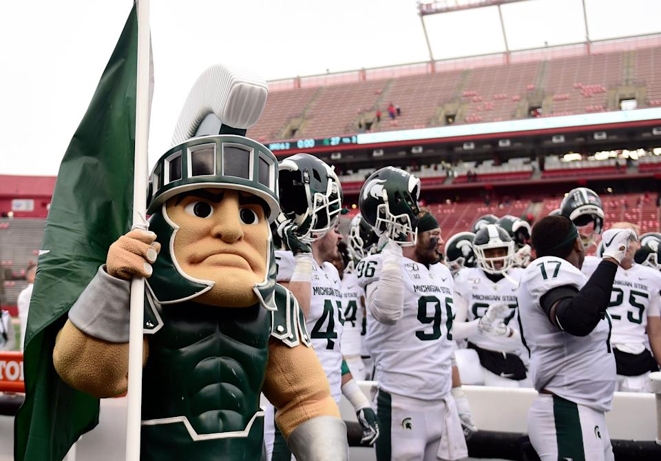 Sparty and the Michigan State Spartans sing the alma mater after their 27-0 win over Rutgers, Nov. 23, 2019 in Piscataway, New Jersey.