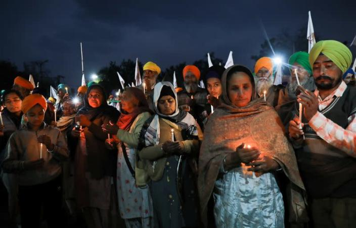Candlelit vigil in memory of a person who died during tractor rally, at Singhu Border near New Delhi