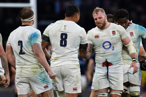 England's flanker James Haskell (2nd R) congratulates No. 8 Nathan Hughes following their Six Nations rugby union match against Scotland, at Twickenham in London, in March 2017