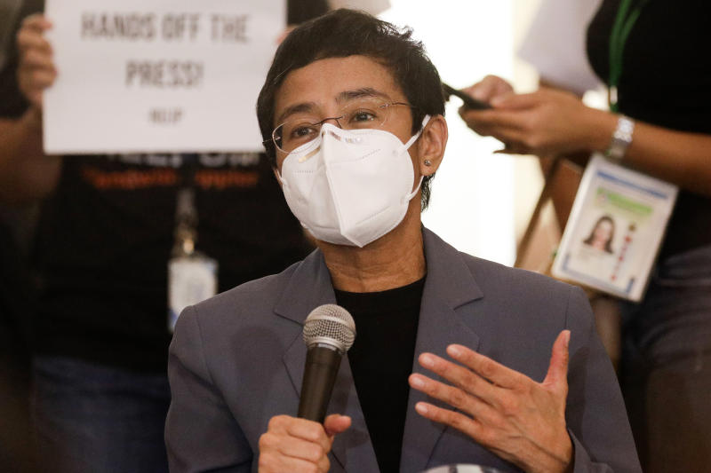 Rappler CEO and Executive Editor Maria Ressa gestures during a press conference near the Manila Regional Trial Court in Manila, Philippines on Monday June 15, 2020. Ressa, an award-winning journalist critical of the Philippine president, was convicted of libel and sentenced to jail Monday in a decision called a major blow to press freedom in an Asian bastion of democracy. (AP Photo/Aaron Favila)