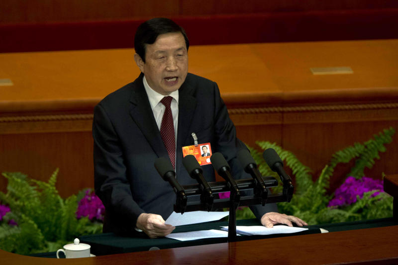 Ma Kai, secretary-general of the State Council, speaks during a plenary session of the National People's Congress held at the Great Hall of the People in Beijing, China, Sunday, March 10, 2013. Ma read out the report on the Cabinet's plan to streamline government ministries, doing away with the powerful Railways Ministry and creating a super-agency to regulate the media and realigning other bureaucracies in a bid to boost efficiency. (AP Photo/Ng Han Guan)