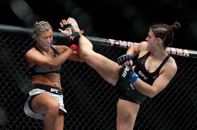 Ashley Yoder (L) blocks a kick from Mackenzie Dern during their women's strawweight bout during UFC 222 at T-Mobile Arena on March 3, 2018 in Las Vegas, Nevada. (Getty Images)