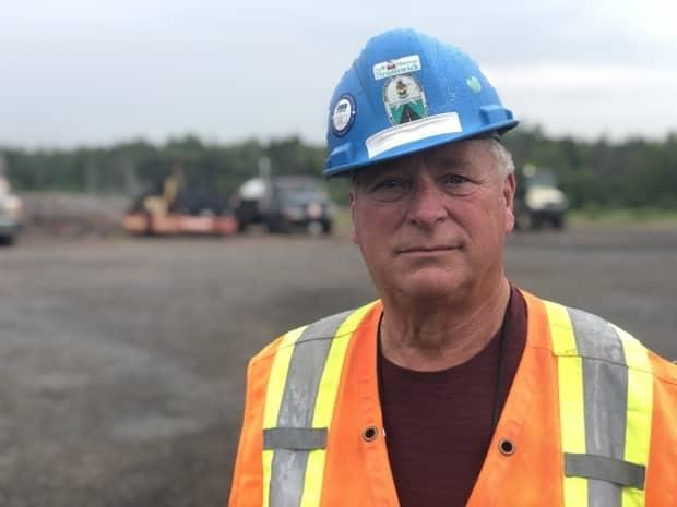 Although it can involve a lot of standing and watching, longtime highway worker Philip Duplisea says he's enjoyed his 50 years on the job. (Gary Moore/CBC - image credit)