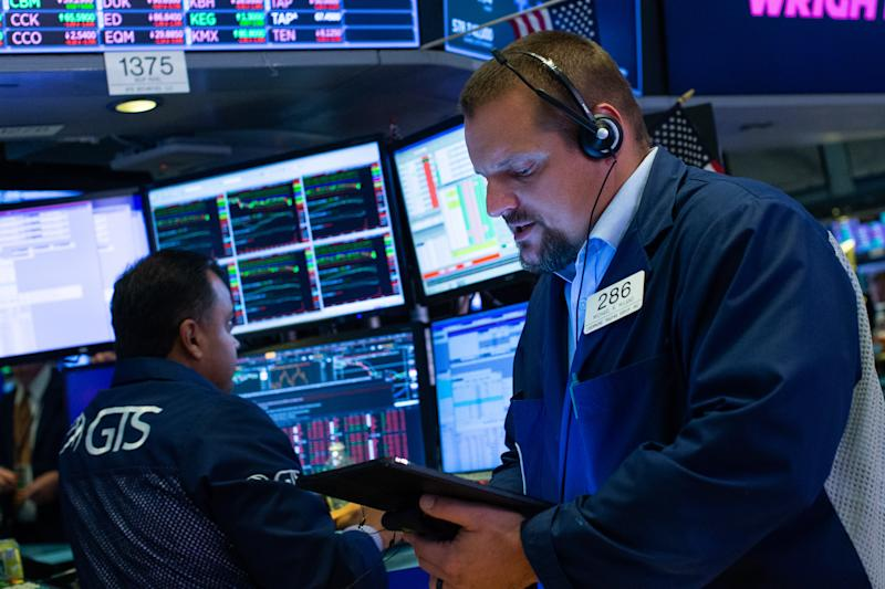 NEW YORK, NY - AUGUST 23: Traders work on the floor of the New York Stock Exchange (NYSE) on August 23, 2019 in New York City. The three major U.S. stock indexes ended lower, being their fourth consecutive week with some declines. (Photo by Eduardo Munoz Alvarez/Getty Images)
