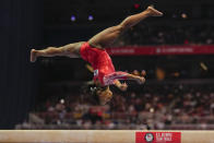 Simone Biles competes on the balance beam during the women's U.S. Olympic Gymnastics Trials Sunday, June 27, 2021, in St. Louis. (AP Photo/Jeff Roberson)