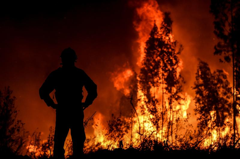 A firefighter monitors the progression of a wildfire at Amendoa in Macao, central Portugal on July 21, 2019. (Photo: Patricia De Melo Moreira/AFP/Getty Images)