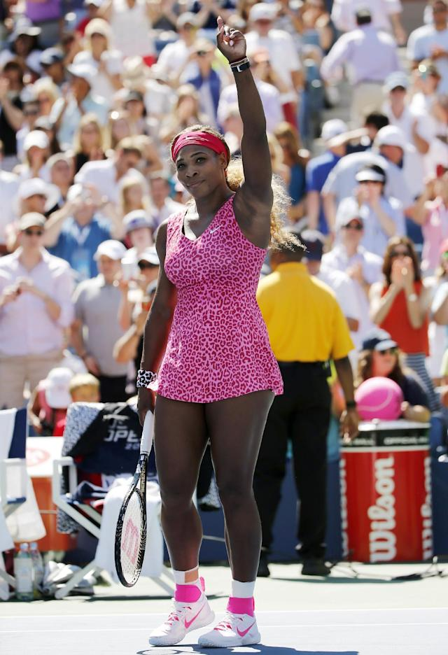 Serena Williams, of the United States, reacts to the crowd after defeating Vania King, of the United States, during the second round of the 2014 U.S. Open tennis tournament, Thursday, Aug. 28, 2014, in New York. (AP Photo/Elise Amendola)