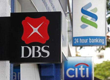 A DBS sign is next to Standard Chartered (top) and Citibank signage in Singapore